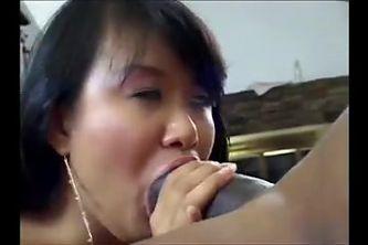 Thick asian milf sucks and fucks huge black cock