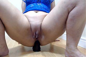 Marcia rides on her black dildo 21