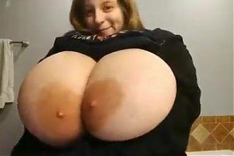 sexy milf showing her huge juicy titties