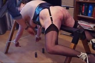 Redslave tied to bench and beaten with plank and cane