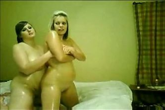 2 Chubby lesbians rubbing their bodies together